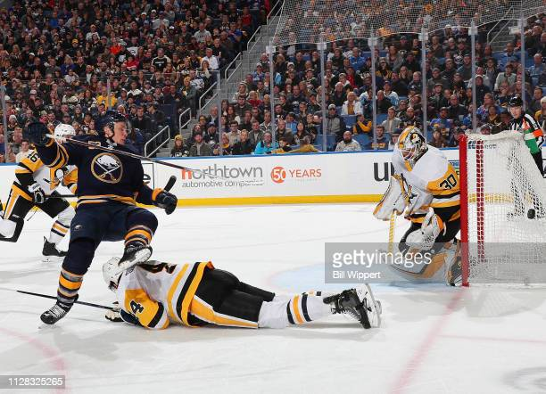 Jeff Skinner of the Buffalo Sabres is defended by Erik Gudbranson and Matt Murray of the Pittsburgh Penguins during an NHL game on March 1 2019 at...