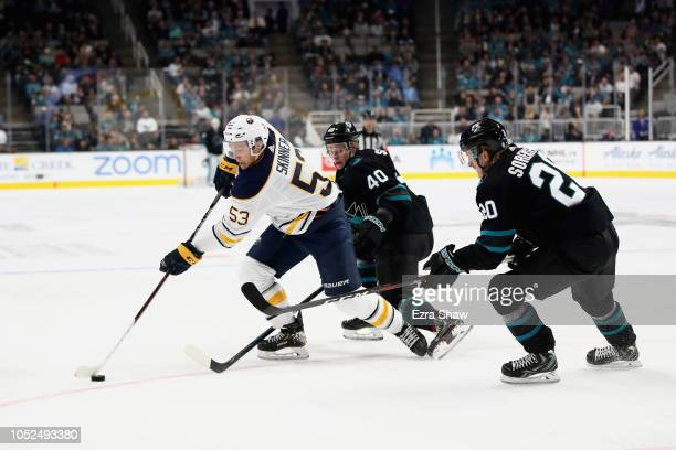 Jeff Skinner of the Buffalo Sabres skates between Antti Suomela and Marcus Sorensen of the San Jose Sharks at SAP Center on October 18 2018 in San...