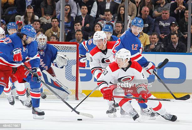 Jeff Skinner of the Carolina Hurricanes and Jesper Fast of the New York Rangers skate for the puck at Madison Square Garden on April 08 2014 in New...