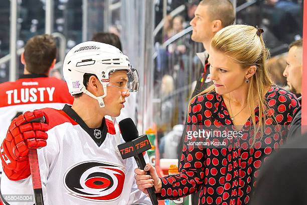 Jeff Skinner of the Carolina Hurricanes answers questions for TSN reporter Sara Orlesky prior to NHL action against the Winnipeg Jets on October 21...