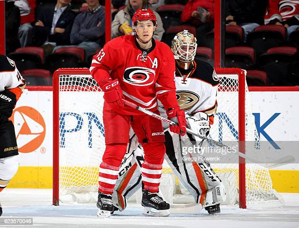 Jeff Skinner of the Carolina Hurricanes attempts to create traffic near the crease Jonathan Bernier of the Anaheim Ducks attempts to protect the net...
