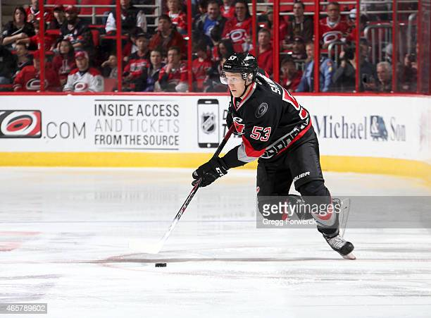Jeff Skinner of the Carolina Hurricanes caries the puck against the Edmonton Oilers during their NHL game at PNC Arena on March 8 2015 in Raleigh...