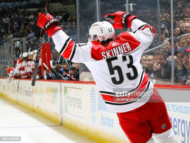 Jeff Skinner of the Carolina Hurricanes celebrates his first period goal against the Winnipeg Jets at the Bell MTS Place on October 14 2017 in...