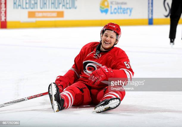Jeff Skinner of the Carolina Hurricanes gets upended and reacts with a smile during an NHL game against the St Louis Blues on April 8 2017 at PNC...