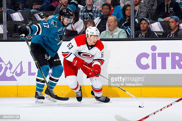 Jeff Skinner of the Carolina Hurricanes handles the puck against John McCarthy of the San Jose Sharks at SAP Center on October 24 2015 in San Jose...
