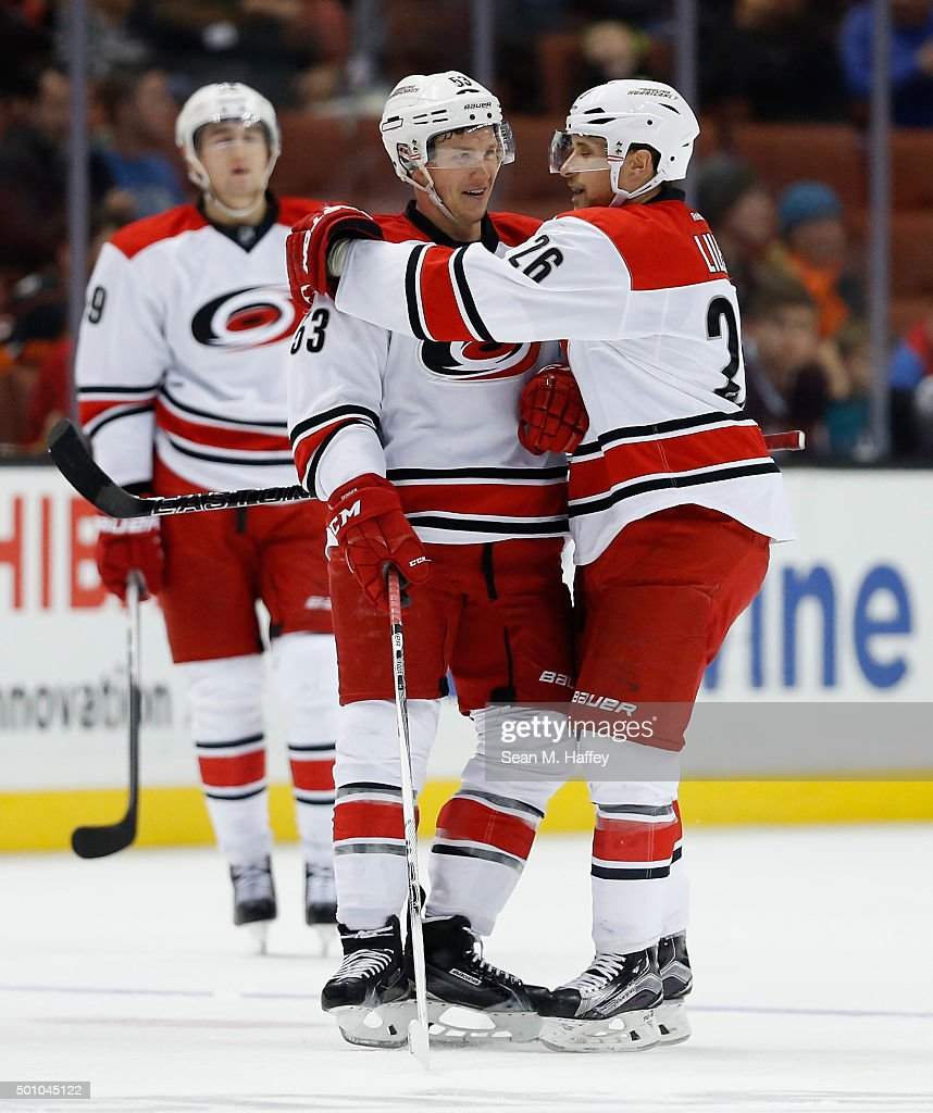 Jeff Skinner #53 of the Carolina Hurricanes is hugged by John-Michael Liles #26 of the Carolina Hurricanes after a goal during the third period in a game against the Anaheim Ducks at Honda Center on December 11, 2015 in Anaheim, California. The Carolina Hurricanes defeated the Anaheim Ducks 4-1.