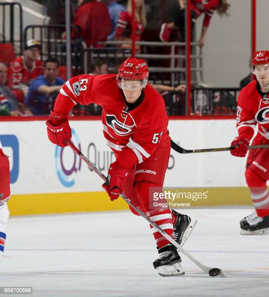 Jeff Skinner of the Carolina Hurricanes prepares to pass the puck during an NHL game against the New York Rangers on March 9 2017 at PNC Arena in...
