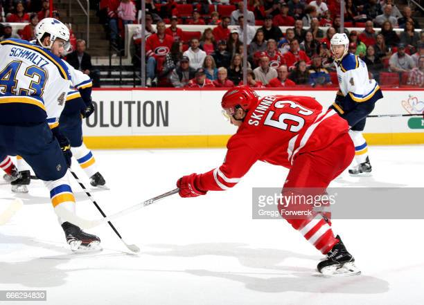 Jeff Skinner of the Carolina Hurricanes scores past the defense of Jordan Schmaltz of the St Louis Blues during an NHL game on April 8 2017 at PNC...
