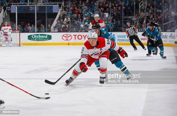 Jeff Skinner of the Carolina Hurricanes skates after the puck against Marcus Sorensen of the San Jose Sharks at SAP Center on December 7 2017 in San...