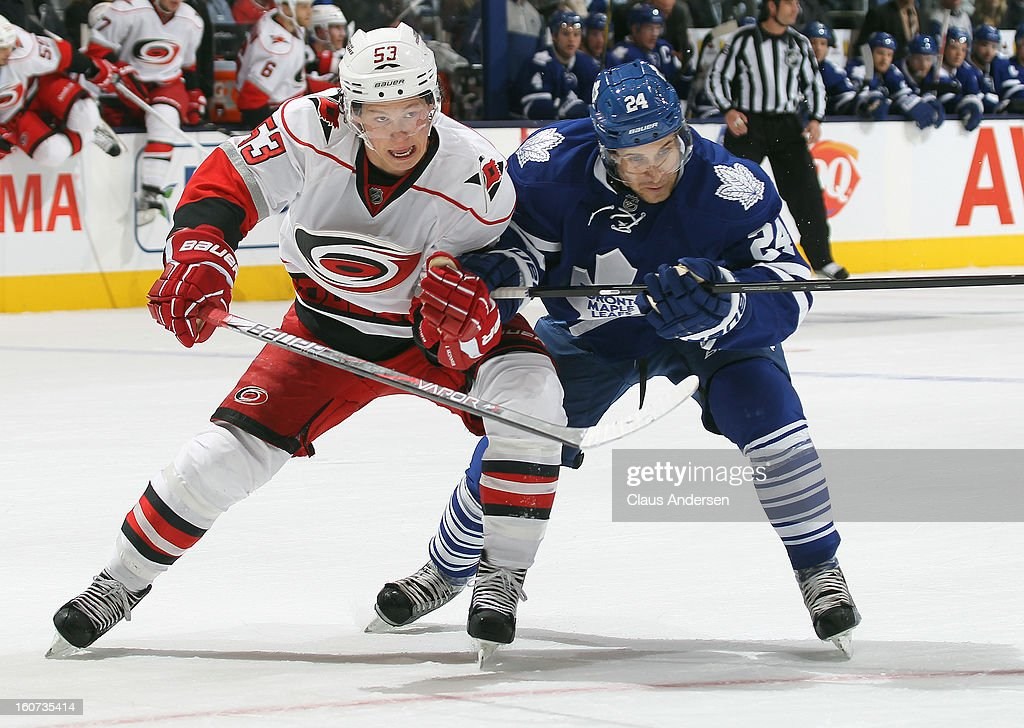Jeff Skinner #53 of the Carolina Hurricanes skates against John-Michael Liles #24 of the Toronto Maple Leafs in a game on February 4, 2013 at the Air Canada Centre in Toronto, Canada. The Hurricanes defeated the Leafs 4-1.