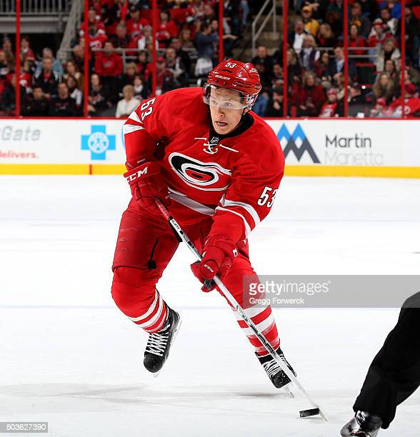 Jeff Skinner of the Carolina Hurricanes skates hard into the offensive zone with the puck during an NHL game against the Nashville Predators at PNC...