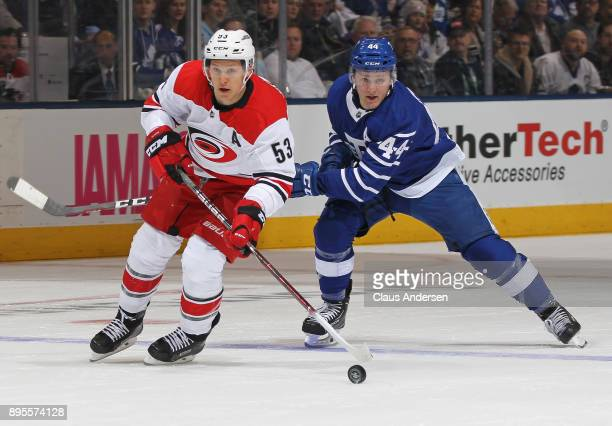Jeff Skinner of the Carolina Hurricanes skates past Morgan Rielly of the Toronto Maple Leafs for shot that he scores on during an NHL game at the Air...