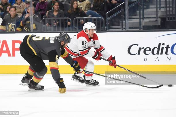 Jeff Skinner of the Carolina Hurricanes skates with the puck while Deryk Engelland of the Vegas Golden Knights defends during the game at TMobile...