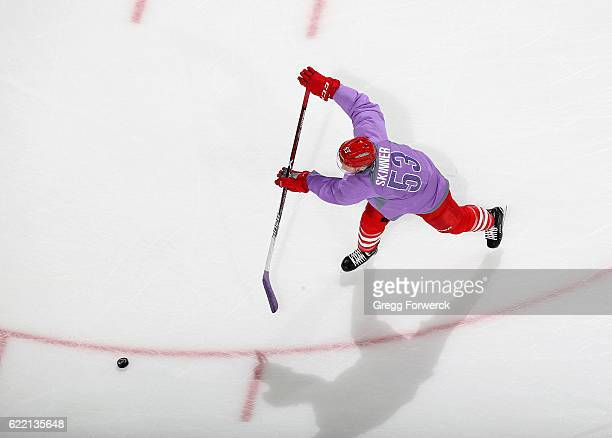 Jeff Skinner of the Carolina Hurricanes taes a shot on goal during pregame warmups while wearing a lavender hockey fights cancer jersey during an NHL...