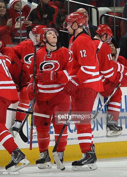 Jeff Skinner of the Carolina Hurricanes watches the replay of his first period goal scored off an assist by Eric Staal during their NHL game against...