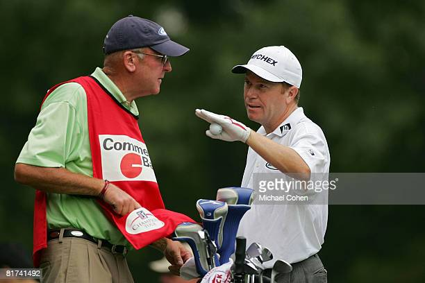Jeff Sluman talks with his caddie Jimmy Walker during the first round of the Commerce Bank Championship at the Red Course at Eisenhower Park held on...