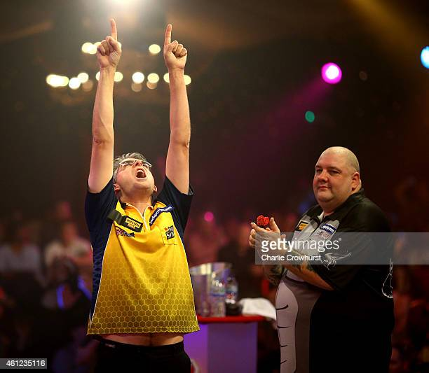 Jeff Smith of Canada celebrates winning his quarter final match against Robbie Green of England during the BDO Lakeside World Professional Darts...