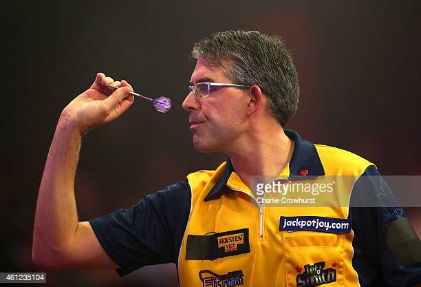 Jeff Smith of Canada in action during his quarter final match against Robbie Green of England during the BDO Lakeside World Professional Darts...