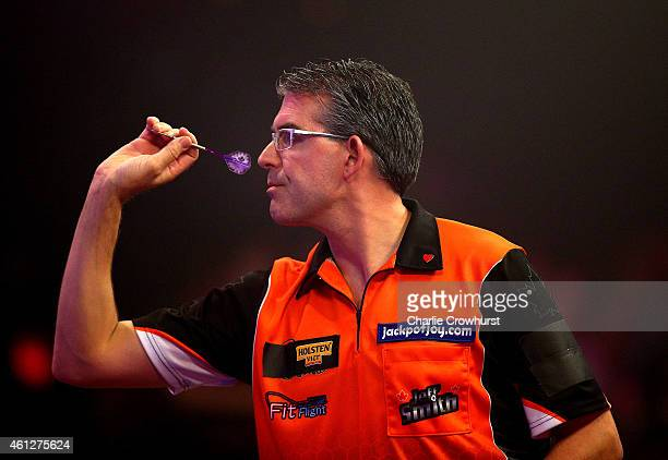Jeff Smith of Canada in action during his semi final match against Scott Mitchell of England during the BDO Lakeside World Professional Darts...