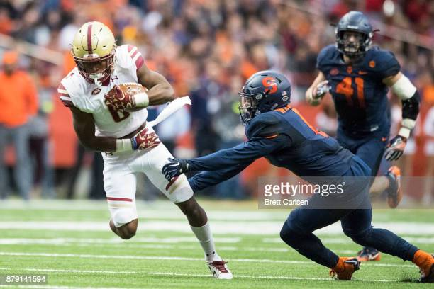 Jeff Smith of the Boston College Eagles is brought down by Rodney Williams of the Syracuse Orange during the third quarter at the Carrier Dome on...