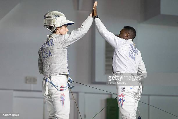 Jeff Spear of the USA and teammate Daryl Homer share a high five during the gold medal match against Argentina in the Team Men's Sabre event The USA...