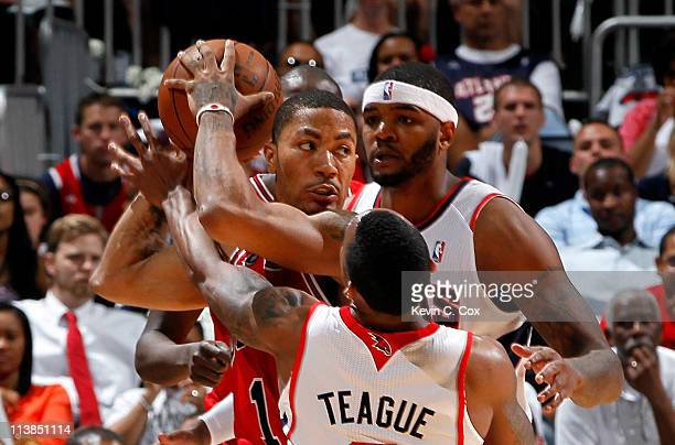 Jeff Teague and Josh Smith of the Atlanta Hawks trap Derrick Rose of the Chicago Bulls in Game Four of the Eastern Conference Semifinals in the 2011...