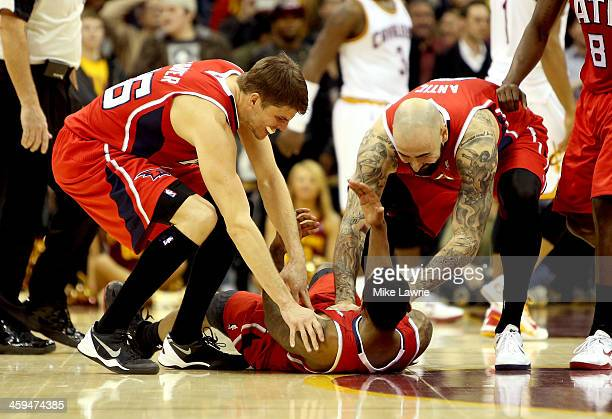 Jeff Teague of the Atlanta Hawks celebrates on the court with Kyle Korver and Pero Antic after scoring the game winning basket in double overtime...