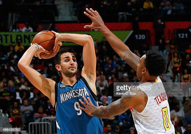 Jeff Teague of the Atlanta Hawks defends against Ricky Rubio of the Minnesota Timberwolves at Philips Arena on November 9 2015 in Atlanta Georgia...