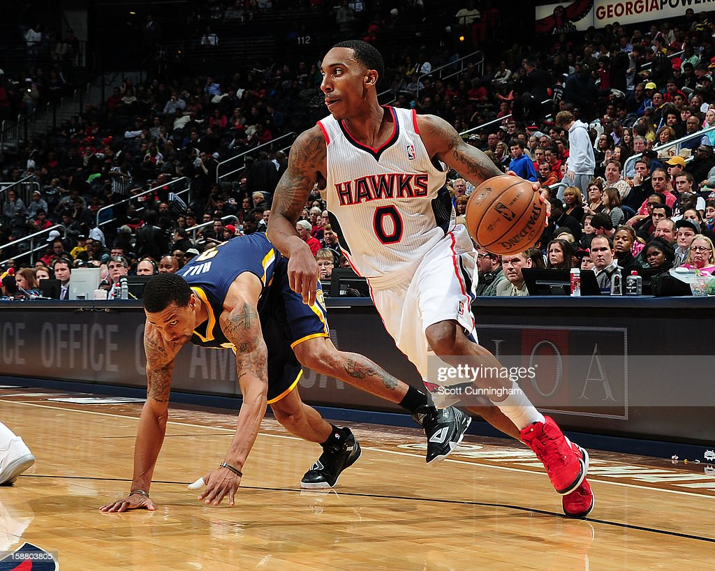 Jeff Teague #0 of the Atlanta Hawks drives against George Hill #3 of the Indiana Pacers on December 29, 2012 at Philips Arena in Atlanta, Georgia.