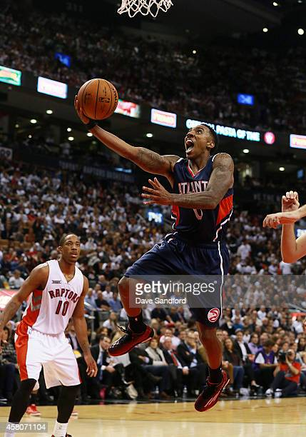 Jeff Teague of the Atlanta Hawks drives to the basket against the Toronto Raptors during their NBA game at the Air Canada Centre on October 29 2014...