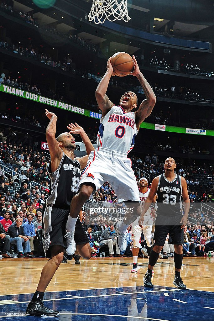 Jeff Teague #0 of the Atlanta Hawks drives to the basket against the San Antonio Spurs on January 19, 2013 at Philips Arena in Atlanta, Georgia.