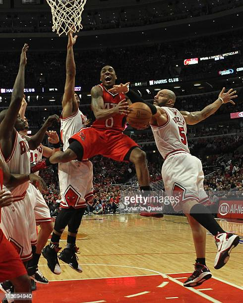 Jeff Teague of the Atlanta Hawks drives to the basket between Loul Deng Joakim Noah Derrick Rose and Carlos Boozer of the Chicago Bulls in Game Two...