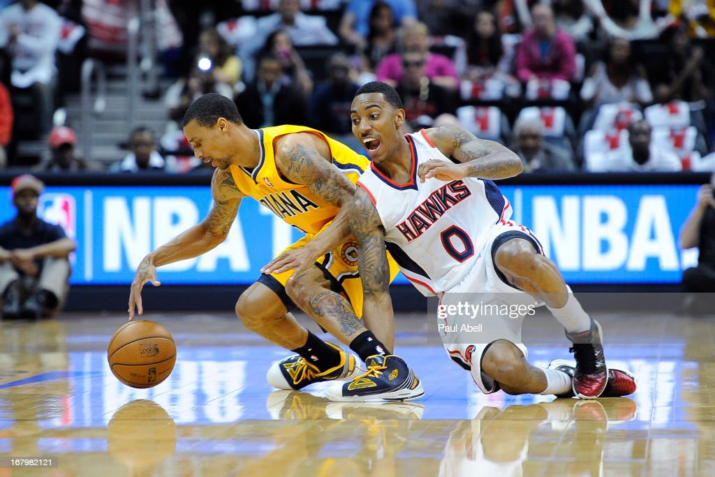 Jeff Teague (0) of the Atlanta Hawks fights for a loose ball with George Hill (3) of the Indiana Pacers during the first half at Philips Arena on May 3, 2013 in Atlanta, Georgia.