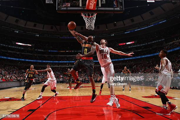 Jeff Teague of the Atlanta Hawks goes for the layup against Pau Gasol of the Chicago Bulls during the game on March 28 2016 at United Center in...