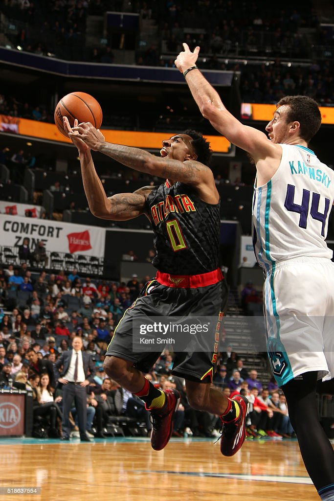 Jeff Teague #0 of the Atlanta Hawks goes for the layup during the game against the Charlotte Hornets on January 13, 2016 at Time Warner Cable Arena in Charlotte, North Carolina.