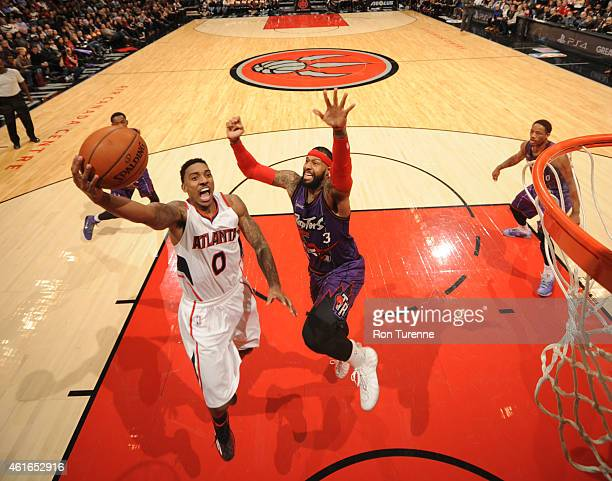 Jeff Teague of the Atlanta Hawks goes up for a shot against the Toronto Raptors on January 16 2015 at the Air Canada Centre in Toronto Ontario Canada...