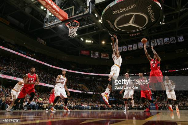 Jeff Teague of the Atlanta Hawks goes up for the shot against Tristan Thompson of the Cleveland Cavaliers at The Quicken Loans Arena on December 26...