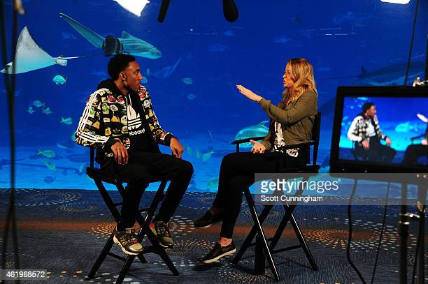 Jeff Teague of the Atlanta Hawks is interviewed by Kristen Ledlow at the Georgia Aquarium on January 20 2015 in Atlanta Georgia NOTE TO USER User...