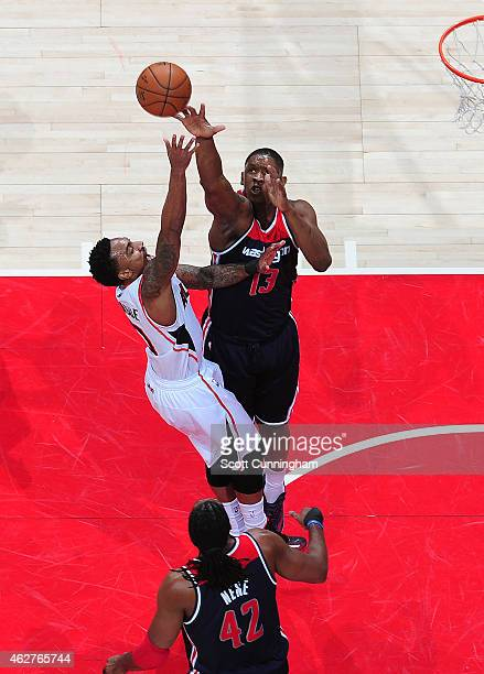 Jeff Teague of the Atlanta Hawks puts up a shot against Kevin Seraphin of the Washington Wizards on February 4 2015 at Philips Arena in Atlanta...
