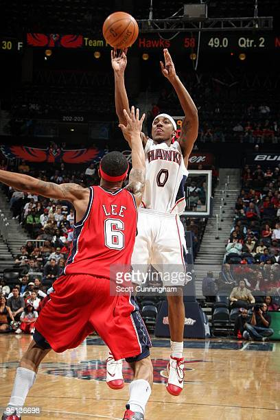 Jeff Teague of the Atlanta Hawks shoots a jump shot against Courtney Lee of the New Jersey Nets during the game at Philips Arena on December 13 2009...