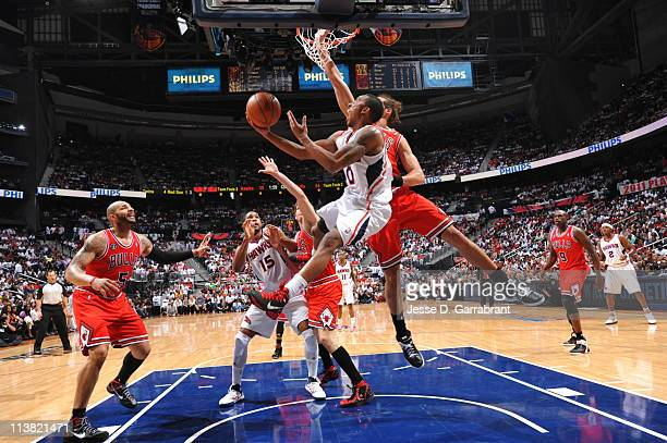 Jeff Teague of the Atlanta Hawks shoots against Joakim Noah of the Chicago Bulls in Game Three of the Eastern Conference Semifinals in the 2011 NBA...