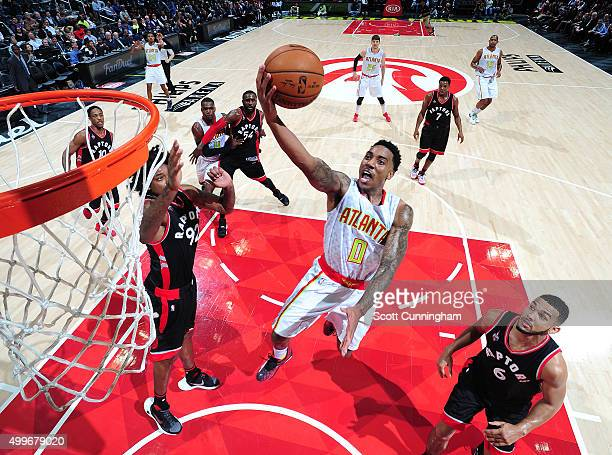 Jeff Teague of the Atlanta Hawks shoots the ball during the game against the Toronto Raptors on December 2 2015 at Philips Arena in Atlanta Georgia...