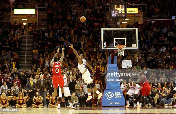 Jeff Teague of the Atlanta Hawks shoots the game winning basket in double overtime against Tristan Thompson of the Cleveland Cavaliers at Quicken...