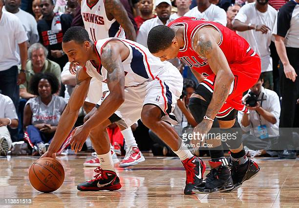 Jeff Teague of the Atlanta Hawks steals the ball from Derrick Rose of the Chicago Bulls in Game Four of the Eastern Conference Semifinals in the 2011...