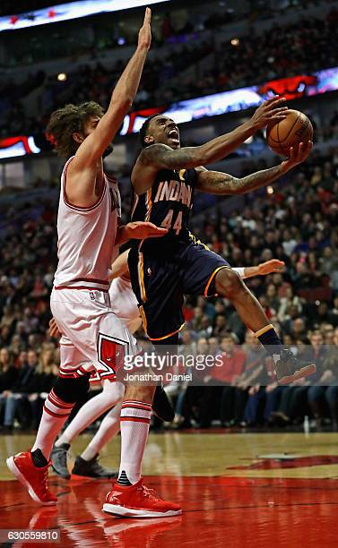 Jeff Teague of the Indiana Pacers drives past Robin Lopez of the Chicago Bulls at the United Center on December 26 2016 in Chicago Illinois
