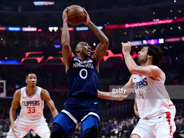 Jeff Teague of the Minnesota Timberwolves attempts a shot between Milos Teodosic and Wesley Johnson of the LA Clippers during the first half at...