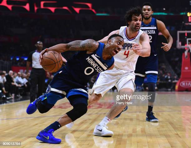 Jeff Teague of the Minnesota Timberwolves drives on Milos Teodosic of the LA Clippers during the first half at Staples Center on January 22 2018 in...