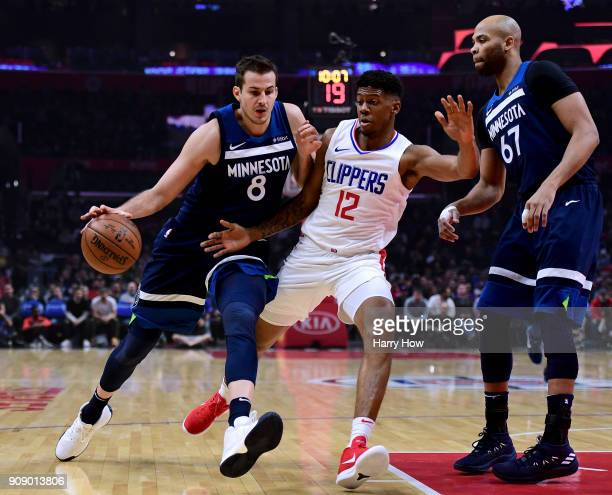 Jeff Teague of the Minnesota Timberwolves drives on Tyrone Wallace of the LA Clippers as Taj Gibson looks on during the first half at Staples Center...