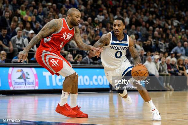 Jeff Teague of the Minnesota Timberwolves drives to the basket against PJ Tucker of the Houston Rockets during the game on February 13 2018 at the...