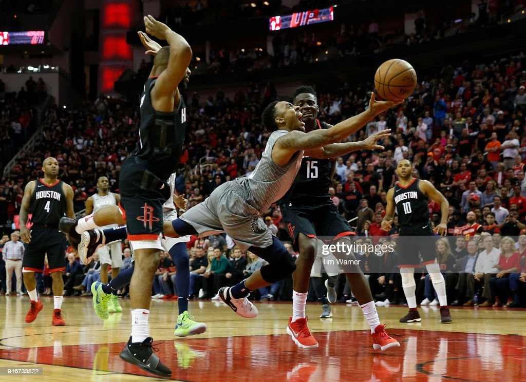 Jeff Teague #0 of the Minnesota Timberwolves goes up for a shot defended by Clint Capela #15 of the Houston Rockets and Chris Paul #3 in the second half during Game One of the first round of the 2018 NBA Playoffs at Toyota Center on April 15, 2018 in Houston, Texas.